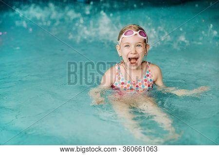 Kids Play In Aqua Park. Children At Water Playground Of Tropical Amusement Park. Little Girl At Swim
