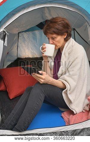 Quarantine At Home. Woman Sit Inside A Tent Enjoying A Cup Of Tea