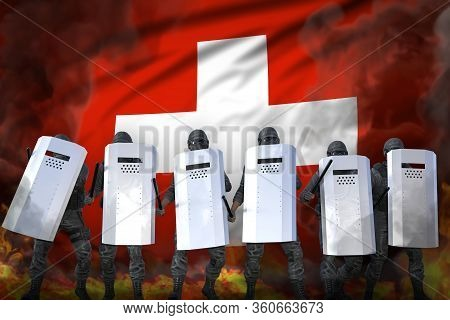 Switzerland Protest Fighting Concept, Police Squad In Heavy Smoke And Fire Protecting Country Agains