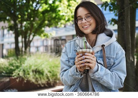 Career, Women And Lifestyle Concept. Attractive Cheerful Queer Girl In Denim Jacket, Glasses, Having