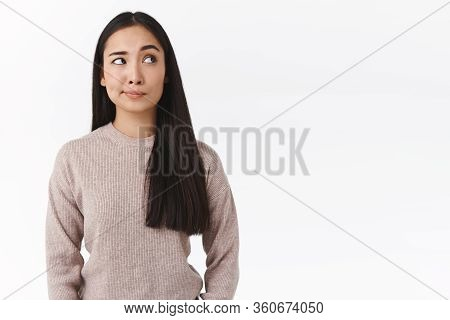 Skeptical, Unsure Attractive Asian Woman With Long Dark Hair, Have Doubts And Hesitation, Making Cho