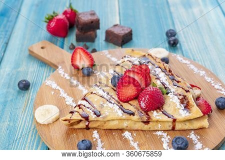 Crepe With Strawberries , Berries And Bananas And Brownies - Strawberry Crepe With Fruits With Choco