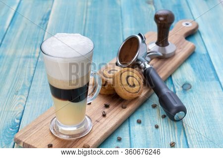 Coffee With Cream Foam On Top And Cinnamon Rolls And Coffee Tools - Frappe With Multi Layers Of Crea