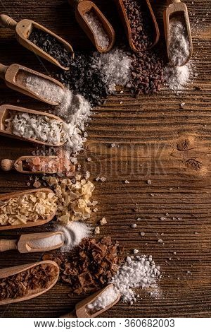 Sea Salts, Smoked Salts, Black And Pink Himalayan Salt Crystals On Wooden Background