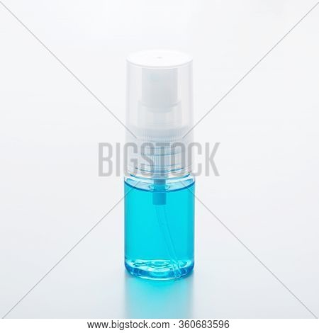 Alcohol In Spray Bottle On White Background