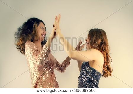 Portrait Of Best Friends, Pretty Girls Having Fun, Indoor Party And Crazy Looking, Laughing.wearing