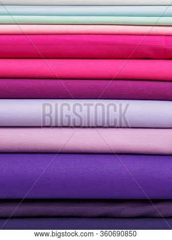 Bright Pink And Purple Fabric Laid In Layers, Close-up. Background With A Bright And Expressive Fabr