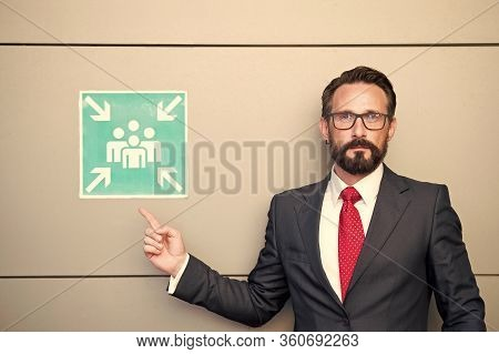 Handsome Professional Leader Pointing To Meeting Point Sign. Man Warning About Place For Meeting. Me