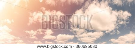 Beautiful Landscape Of Blue Cloudy Sky With Warm Sunny Tonings. Warm And Soft Sunlight Illuminate Sk