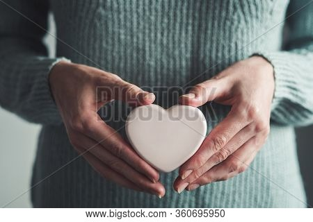 Woman Holds Soap In Her Hands In The Shape Of A Heart. Preventing Diseases By Washing Your Hands. Ag