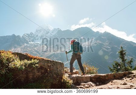 Young Hiker Backpacker Woman Using Trekking Poles Enjoying Everest Base Camp Trekking Route With Tha