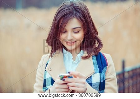 Woman Texting. Closeup Young Happy Smiling Cheerful Beautiful Woman Looking At Mobile Cell Phone Rea