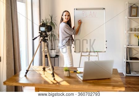 Concept Of Webinars, Online Classes, Online Training. Young Woman In Casual Clothes Shows Informatio