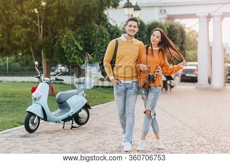 Full-length Portrait Of Loving Couple Enjoying Weekend Together And Walking In Park In Morning. Ador