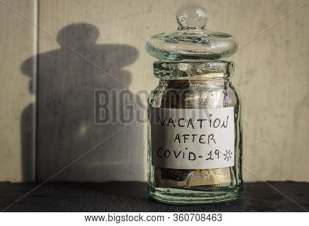 Glass Jar Saves Savings For Vacation After Covid-19 Money Saved In A Boat For When The Pandemic Pass