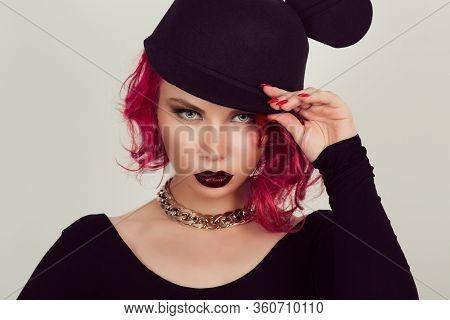 Beautiful Sexy Red Head Vamp Woman With Dark Black Lips In Modern Black Hat. Beauty Fashion Model Gi