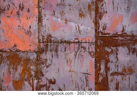 Rusty Wall Made Of Tin Sheets Forming An Up-going Chart. Red Rust Backdrop. Sheets Going Up.