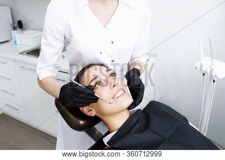 Beautiful Woman With Healthy Teeth. Professional Dentist Examination. Dentist Day.
