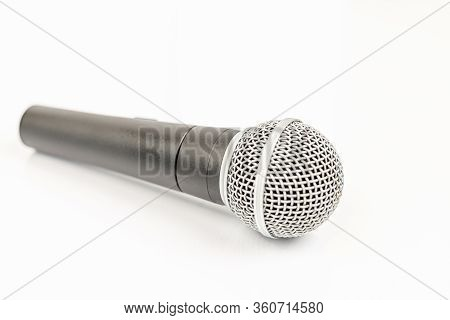 Vocal Microphone Isolated Above White Background. Music Concept With Singing Microphone