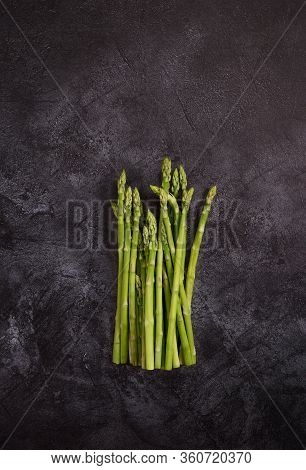 Asparagus At Dark Concrete Background. Frame With Copy Space With Ingredients Of Healthy Food For Te