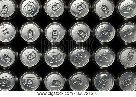 Many beer cans seen from above closeup full frame