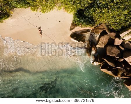 Drone Picture About A Beautiful And Sexy Woman In Red Swimsuit, From High Above At Tropical Beach. B