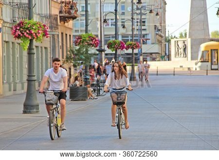 Lodz / Poland. 18 July 2019: Cyclists Ride Bicycles On Street In Lodz. People Ride Bicycles. Tourist