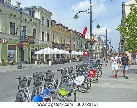 Lodz / Poland. 18 July 2019: View Of City Street With Many Bicycles. Urban Transport. Row Of Bicycle