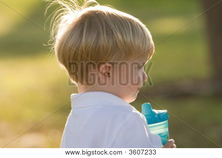 Young Boy With His Sippie Cup