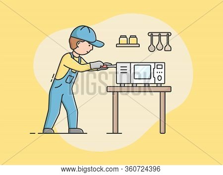 Concept Of Electric Appliances Service. Professional Worker Repairman In Uniform Fixes Microwave. Ch
