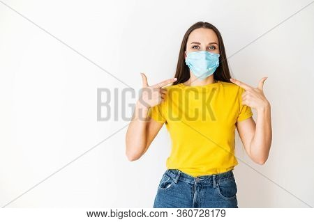 Safety During A Pandemic, Epidemic, Seasonal Flu. Positive Teenager Girl In A Medical Mask On Her Fa