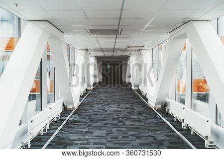 Bright Long Modern Passageway Between Two Towers Of An Office Or A Hospital Skyscraper With  Zig-zag