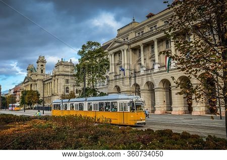 Budapest, Hungary - Nov 6, 2019: Yellow Tram In Front Of The Ministry Of Agriculture Building. Museu