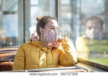 A Young Woman In An Empty Public Transport During The Pandemic. Coronavirus.