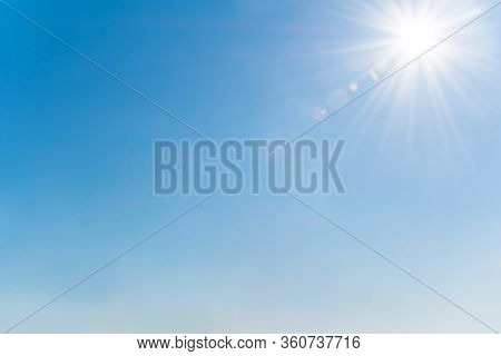 Clear Blue Sky With Sun And Sunrays. Daytime And Good Weather