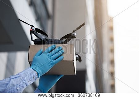 Man Using Drone For Fast Delivery Of Package With Products, Safety Delivery On Quarantine, Copy Spac