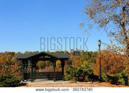 At The East Mountain Overlook, The Crescent Hotel Rises Above The Orange And Gold Of Autumn In Eurek