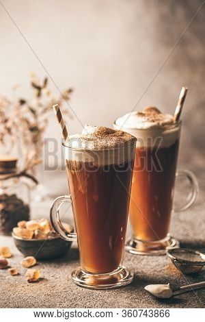 Iced Coffee In A Tall Glasses With Cream Poured Over