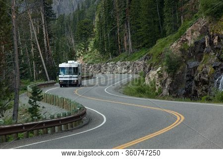 Yellowstone National Park, Wyoming / Usa - July 16, 2014:  A Motor Home Driving On A Curvy Section O