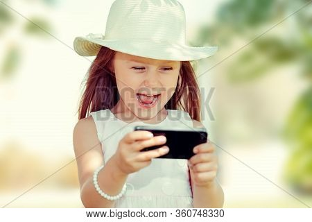 Girl Texting. Closeup Young Happy Smiling Cheerful Girl Looking At Mobile Cell Phone Reading Sending