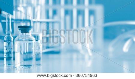 Serum Liquid Bottle To Test Tube, Laboratory Research And Development Concept. Scientist Sample Chem
