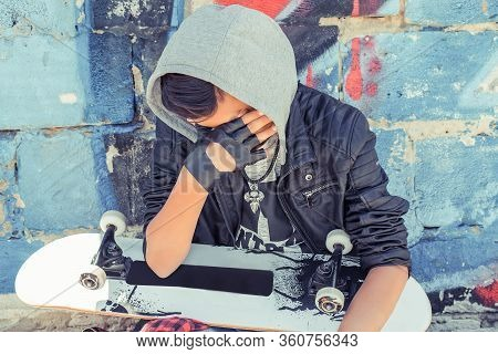 Sad Crying Teenager Boy With Skateboard In City Over Blue Red Graffiti Urban Background