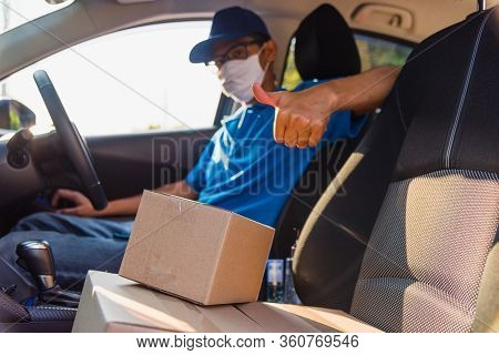 Asian Young Delivery Man Courier Online With Boxes With Uniform Sitting In Driving Car He Protective