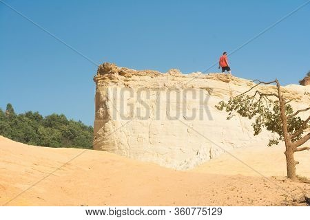 Roussilion,france-august 13,2016:tourists With Red T-shirt Visiting The Famous Ocra Color Quarries N