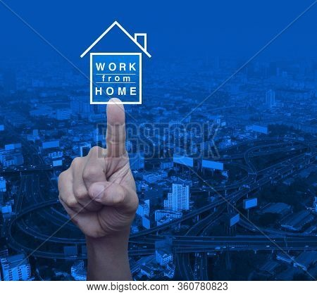 Hand Pressing Work From Home Flat Icon Over Modern City Tower, Street, Expressway And Skyscraper, Bu
