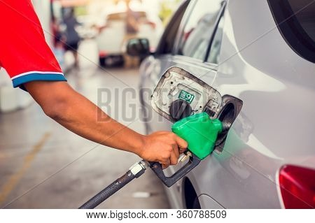 Hand Refilling The Car With Fuel At The Gas  Station, Car In Gas Station, Refilling The Car With Fue