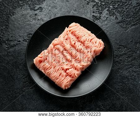 Raw Turkey Breast Fillets Minced Meat On Black Plate Ready To Cook