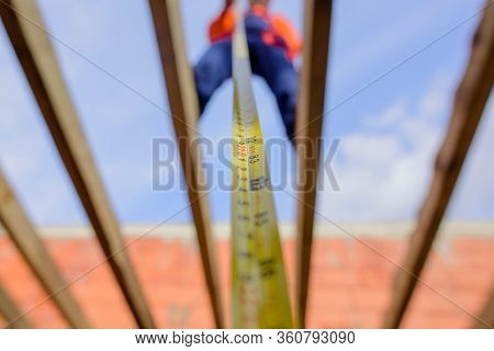 Builder Equipment. Measuring Device. Selective Focus. Builder With Tape Measure. Construction Worker