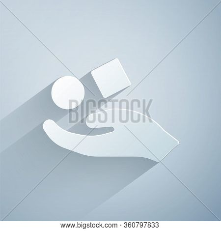 Paper Cut Cube Levitating Above Hand Icon Isolated On Grey Background. Levitation Symbol. Paper Art