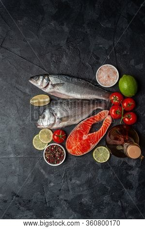 Fresh Dorado, Seabass And Salmon Fishes On Bord Prepared To Cooking, Vegetables And Fresh Sea Food.